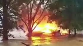 wv 1000 year flood burning floating house